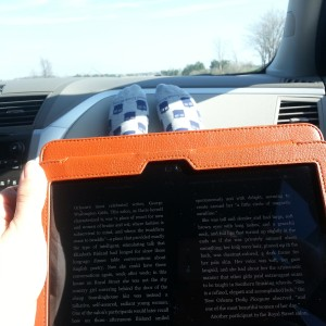 Reading the book club selection on my Kindle in the car...note the Tardis socks.