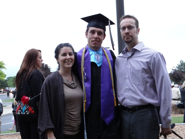 proud aunt and uncle (my boys get their not smiling for pictures gene from their dad)