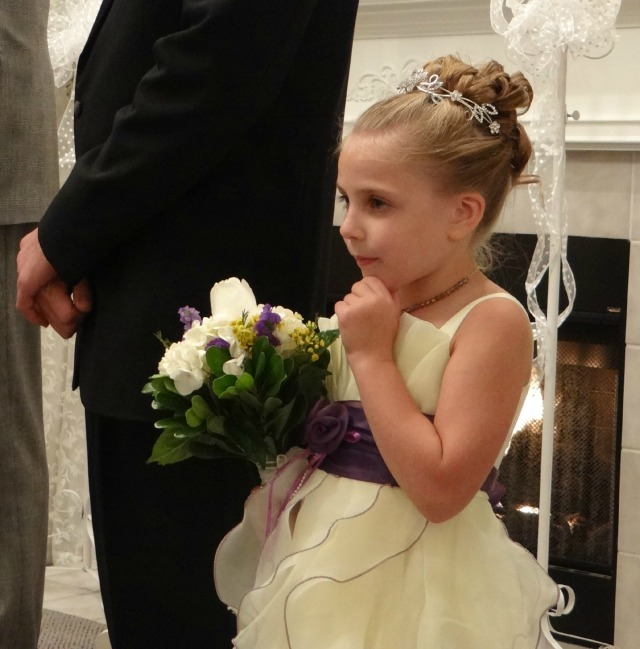 My niece watching the bride walk down the aisle